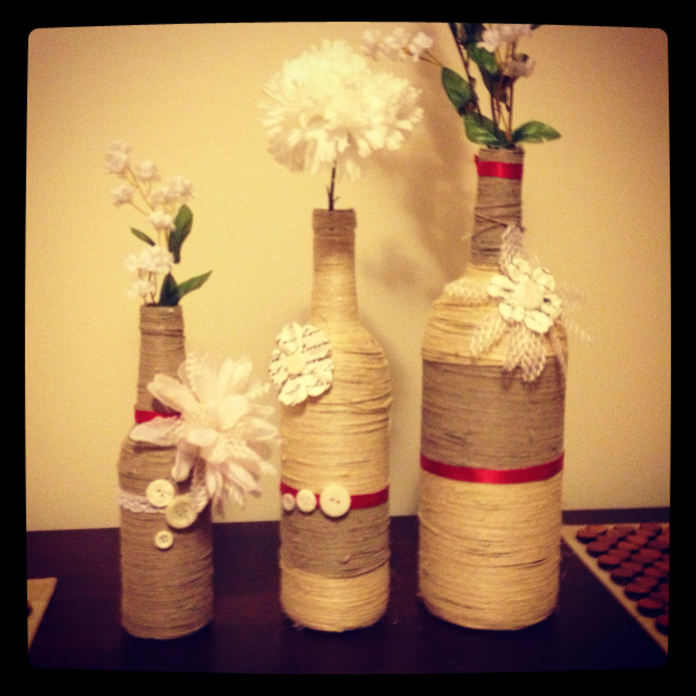 DIY wine bottle vases - used hemp and fun decorative accents from Joann fabrics