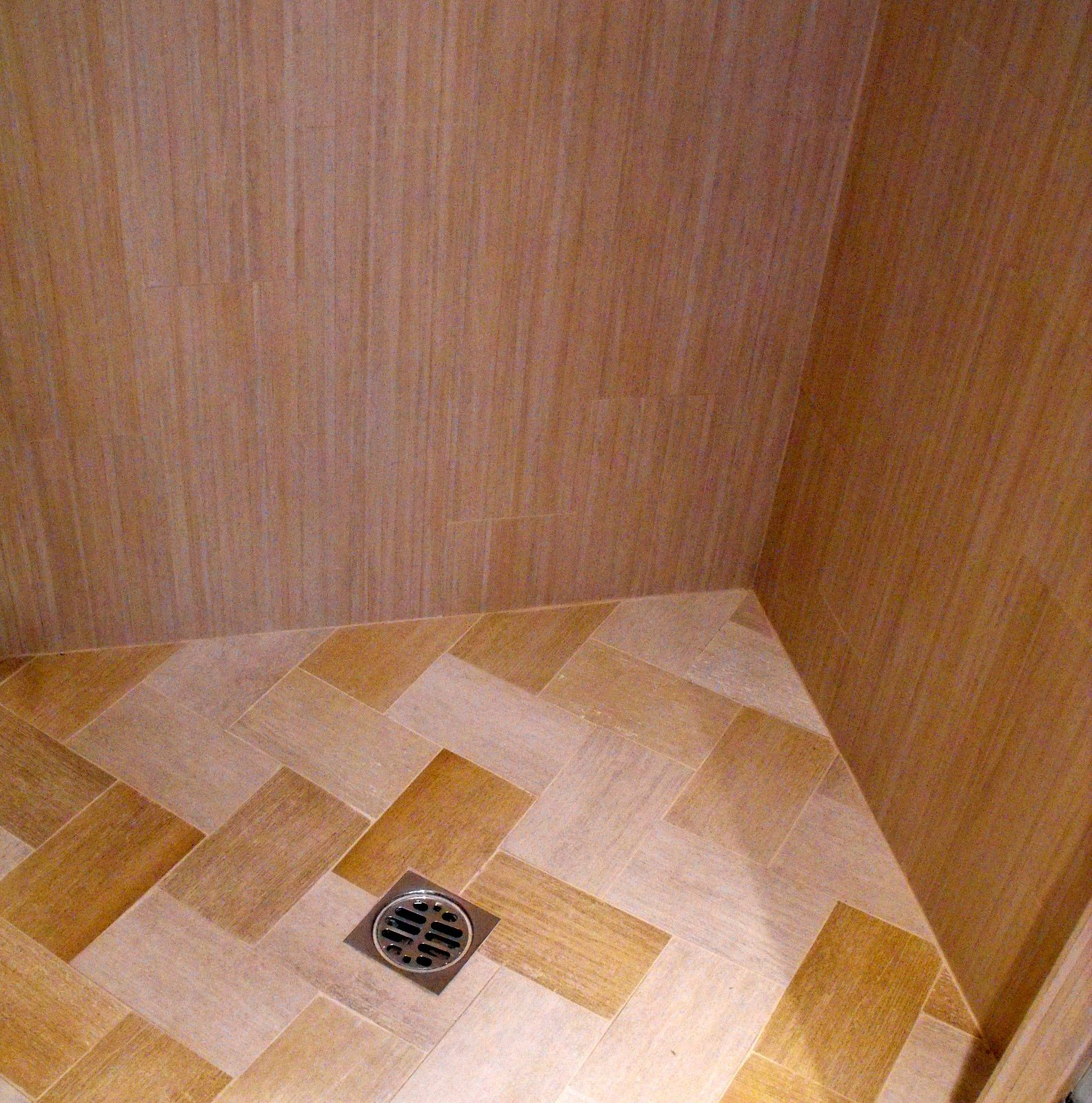 Inside shower stall Modern large tiles used on walls with the ...