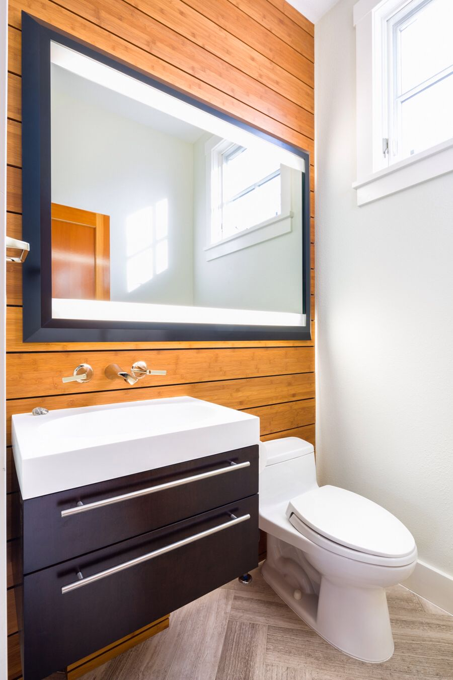 Modern powder room. Bamboo wall cladding. Floating vanity. Mirror ...