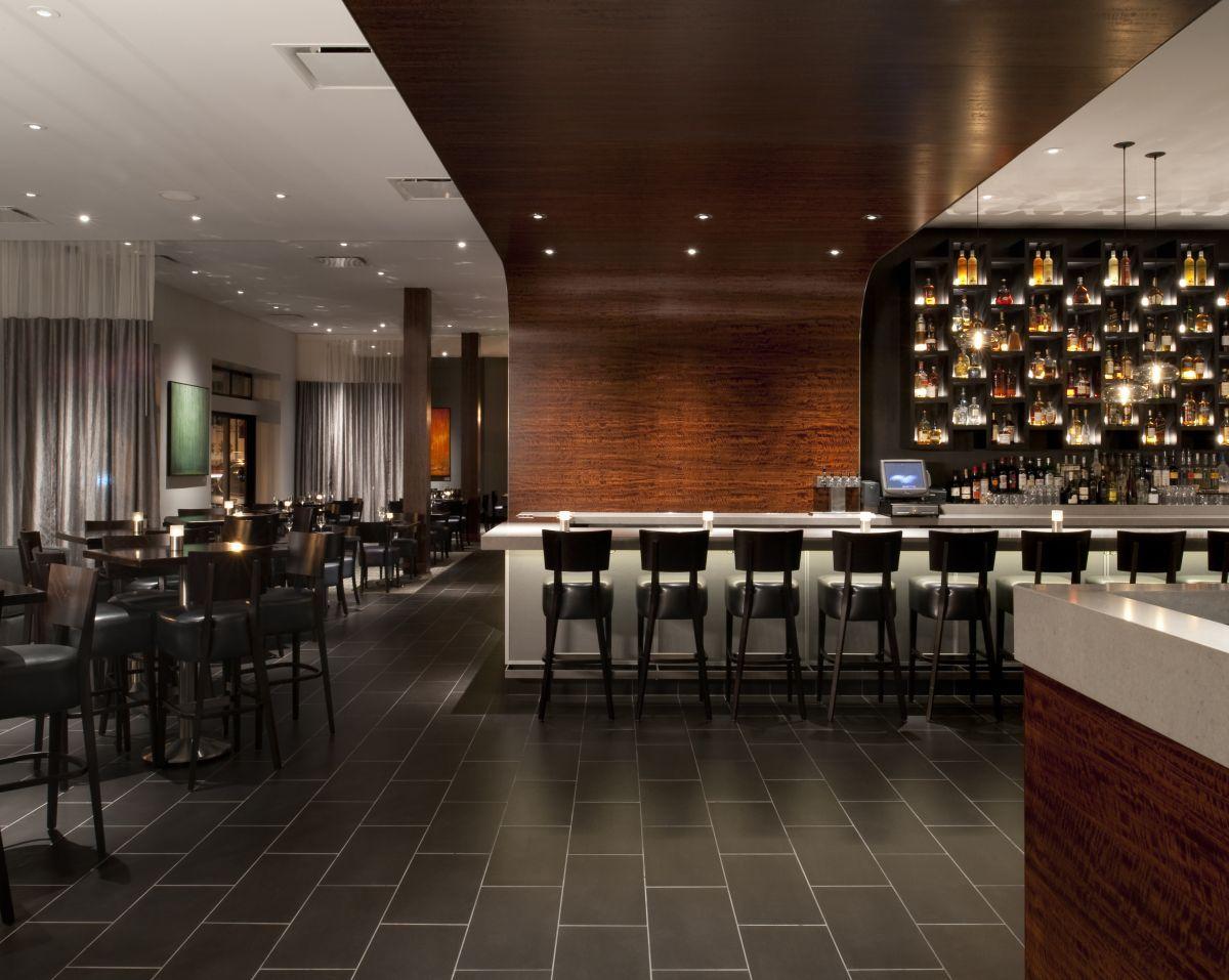 Vesu Restaurant Featuring Niche Modern Aurora Pendant Lights Over Bar