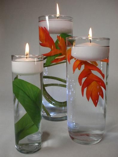 Clean And Simple Love This For My Sisters Wedding But With Teal And Orange Flowers Diy Wedding Decorations Floating Candle Centerpieces Floating Flowers