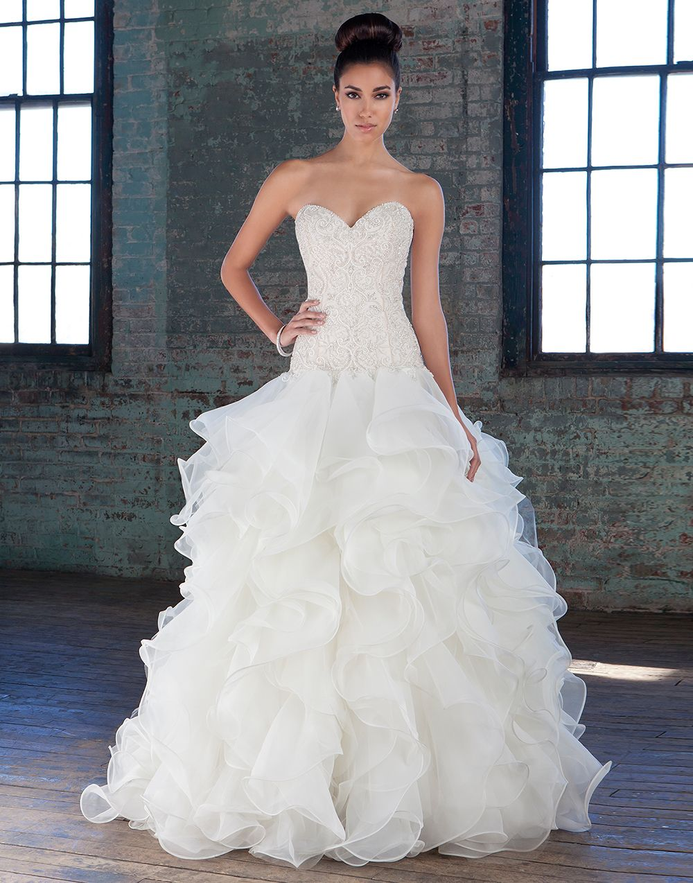 Spectacular  signature wedding dresses style The intricately hand beaded crystal and pearl sweetheart bodice dropped waistline and full organza ruffle skirt