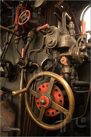 Picture of details of a vintage steam train driving cabin.  I can remember my Uncle Charlie with his oil can going along the train as it waited at the station for departure time.