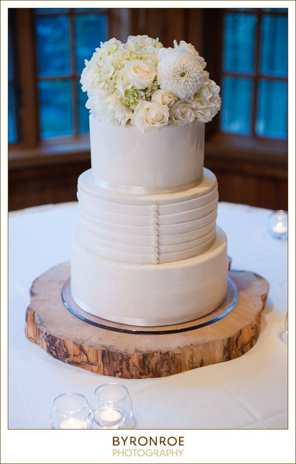 Simple and romantic wedding cake with fresh flowers. Made ...