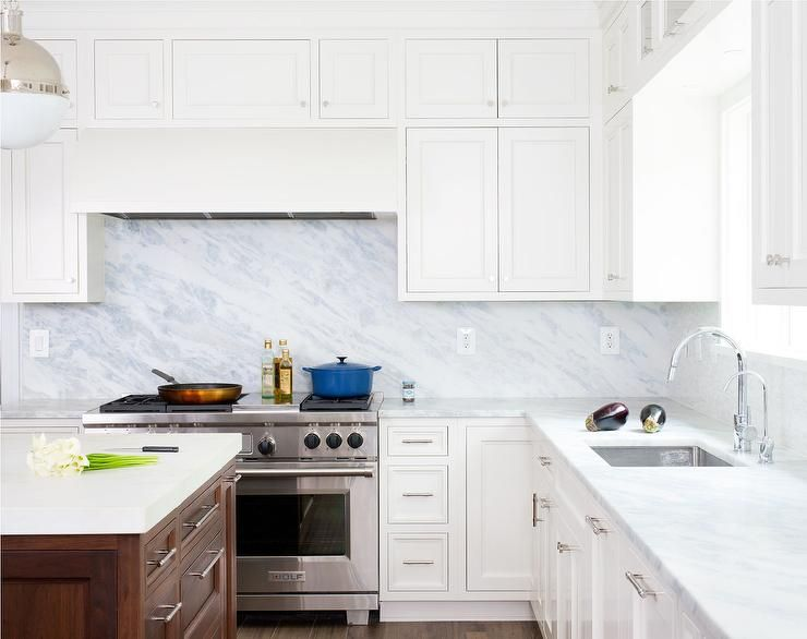 Fantastic Kitchen Features White Cabinets Paired With Blue Marble