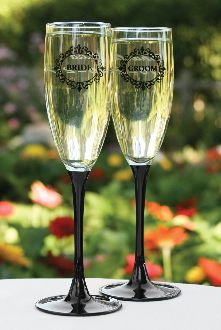 "Bride and ""Groom"" flutes feature black filigree designs and black stems for a classy look. 8 1/4"" tall. Set of two."