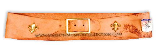 Marilyn Monroe's Personal Leather Belt.         From the 1999 Christie's Auction, The Personal Property of Marilyn Monroe, a soft leather belt in brown, ornamented with gold tone fleur-de-lis and French coat of arms.