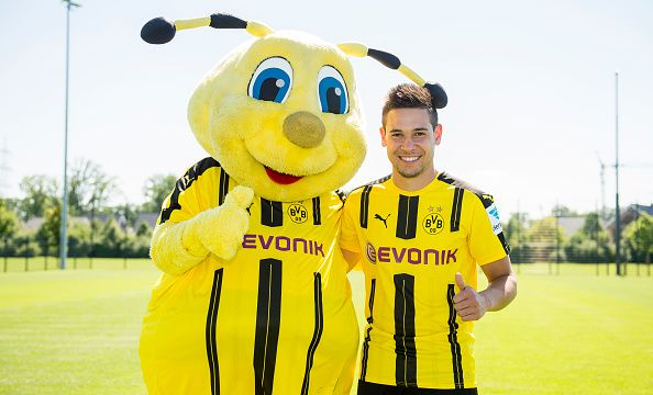 Dortmund S Raphael Guerreiro Poses During With Mascot Emma At The Team Presentation Of Borussia Dortmund On August 17 2016 In Borussia Dortmund Dortmund Photo