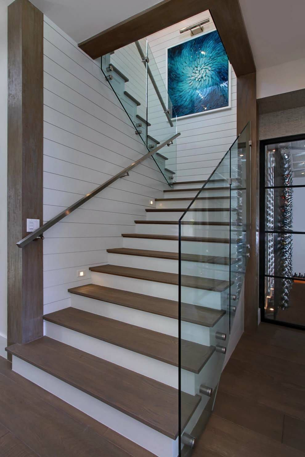 Gorgeous Newport Beach House Evoking A Traditional Coastal Style Glass Railing Stairs Glass Stairs Staircase Design