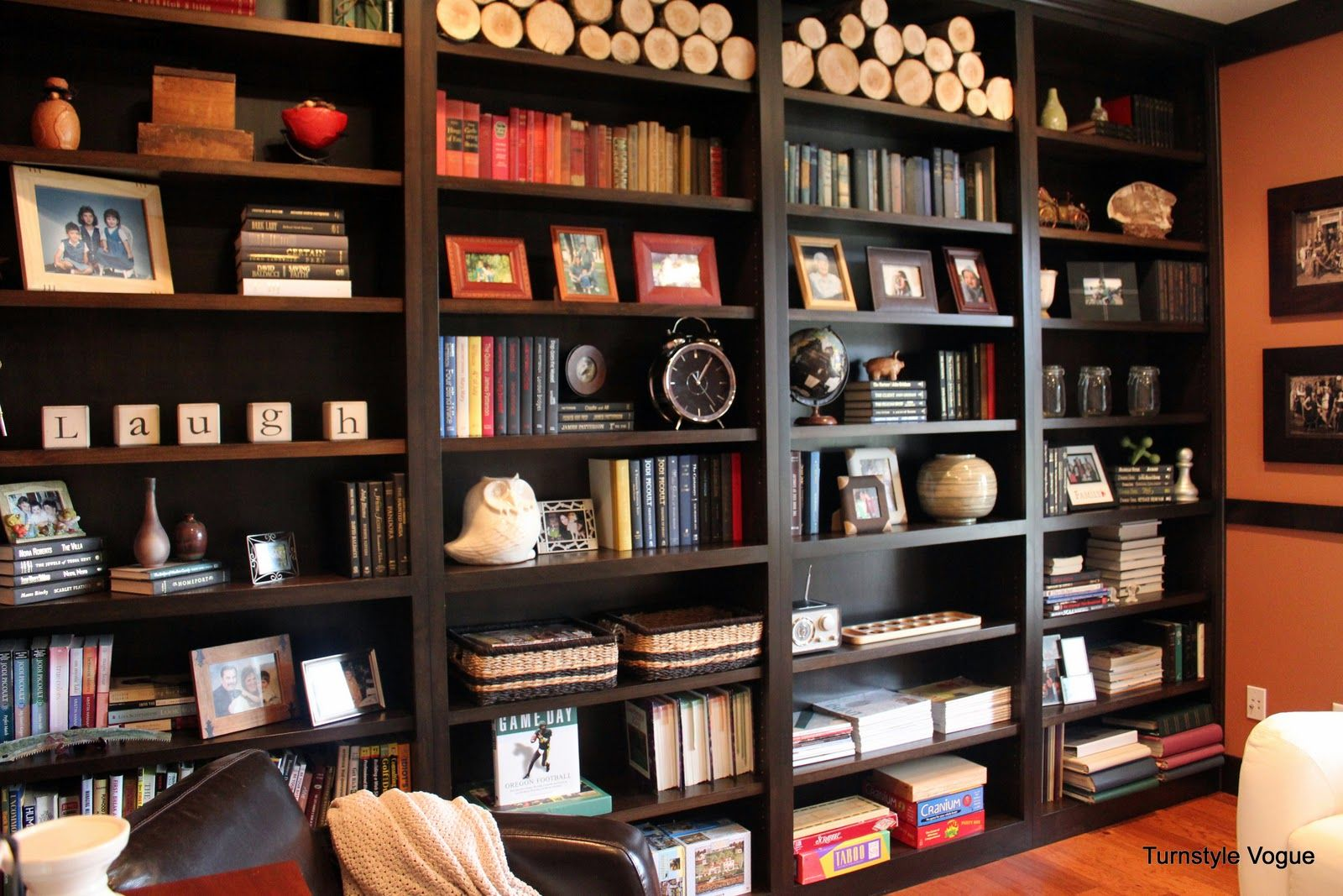 Dark Shelving Are Perfect For A More Masculine And Sophisticated Look Decorating Bookshelves Bookshelf Decor Bookshelf Design