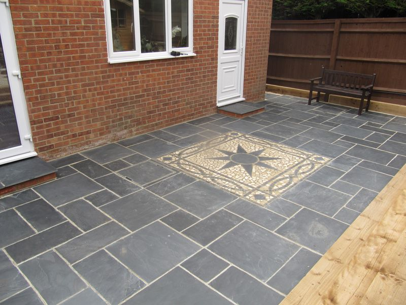 slate paving slabs with a decorative buff coloured feature paving