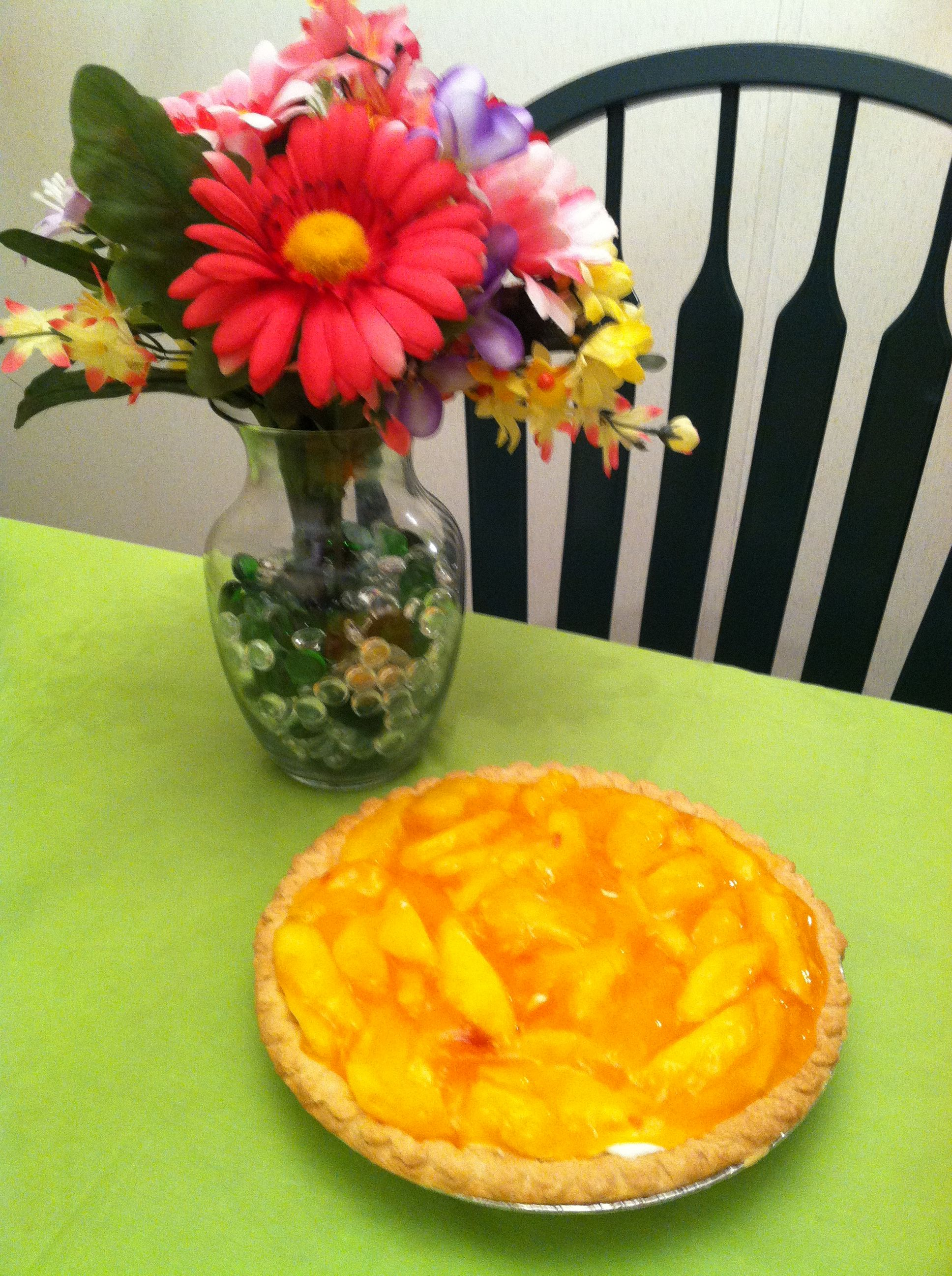 This is a peach pie I made. I found the recipe here on Pinterest somewhere, I think. I was absolutely wonderful. Background vase arrangement is something I threw together with left over flowers I had on hand.