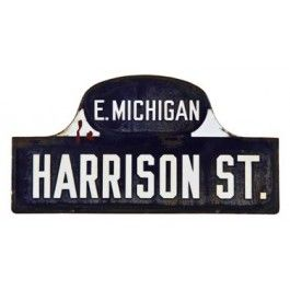 """original early 20th century """"humpbacked"""" style cobalt blue porcelain enameled kalamazoo city street sign - indestructible sign co., columbus, oh.  UR #: UR-9325-11  DESCRIPTION    original early 20th century double-sided die cut steel """"humpbacked"""" street sign removed long ago from the streets of kalamazoo, mi. the signpost street sign features """"harrison"""" and """"e. michigan"""" in bold white lettering against a cobalt blue porcelain enameled background. the original steel or wrought iron bracket…"""