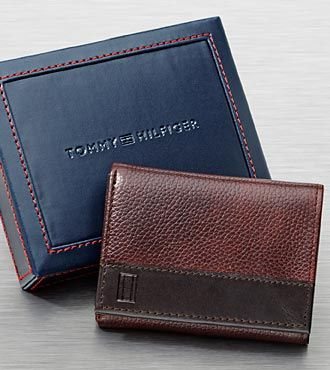 6552f3eb2 The Tommy Hilfiger Men's Brown Tri-Fold Wallet is the perfect gift for any  occasion. This casual, classic, brown leather tri-fold boasts a 3-way  opening, ...