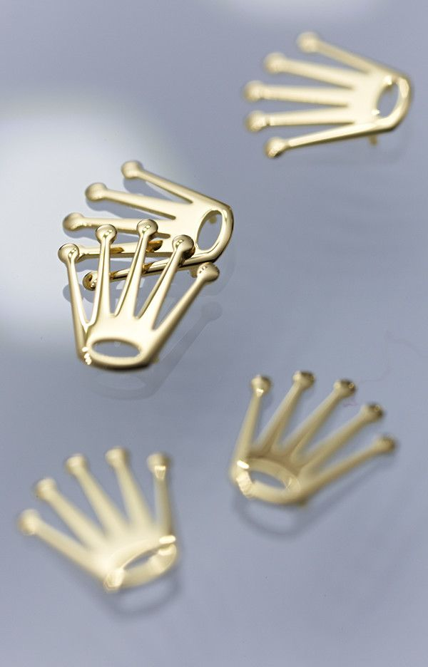 Rolex crown appliques in 18ct yellow gold awaiting placement