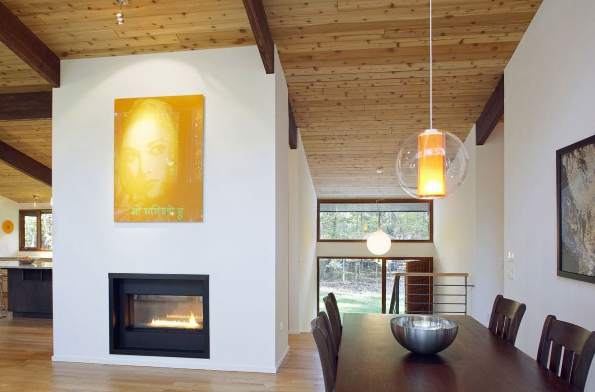 modern fireplace art dining table deck house renovation in