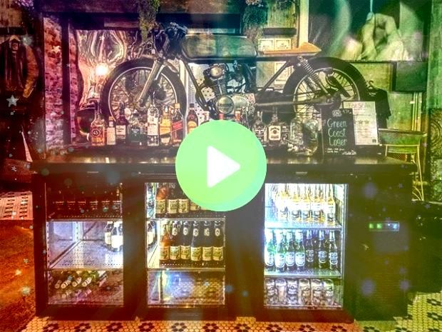 The Smoked Garage Cafe a place for all kind of motorcycle enthusiastics featuring rustic and weathered touches like exposedbrick walls wooden beamsvintage decorations and...