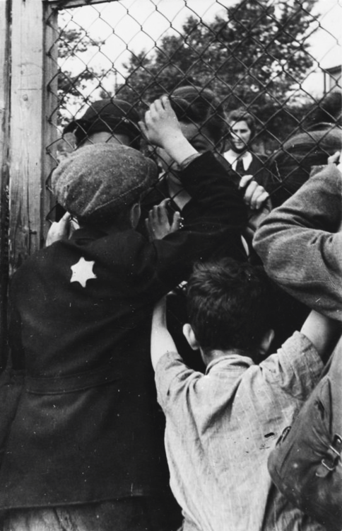 Jewish children say goodbye to their parents after being separated for deportation. Lodz, 1942.Unattributed