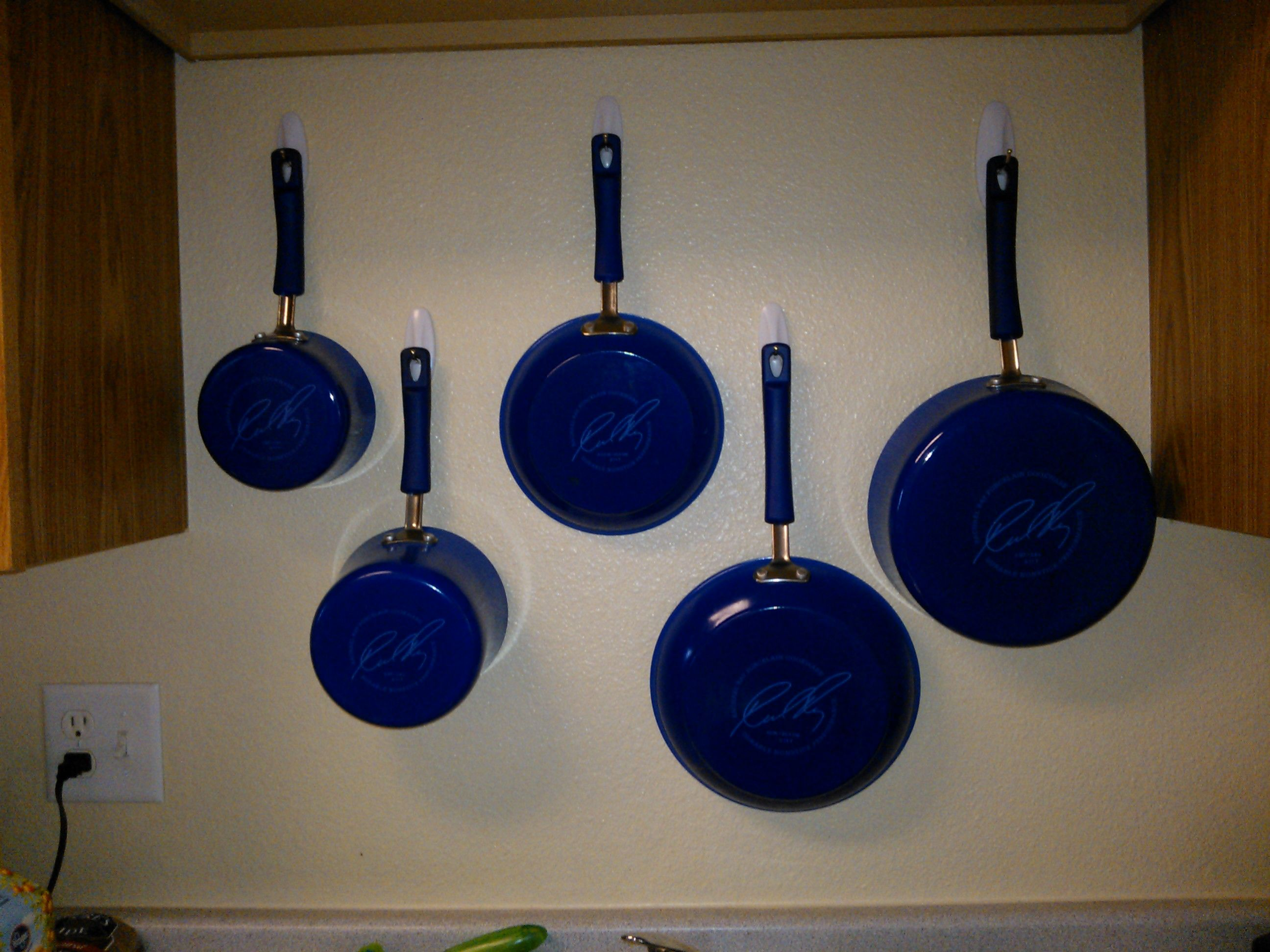 Pots and Pans mounted on the wall with command hooks. in ...