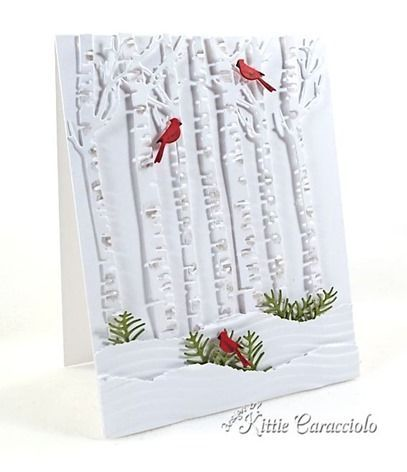 handmade Christmas card from KC ...  Impression Obsession Birch Trees die cuts ... white on white with a pop of red and green  ... two red birds in the trees ... greenery clumps rise from layered snow banks ... great card!!
