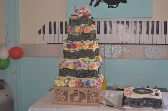 Music wedding cake with handmade roses