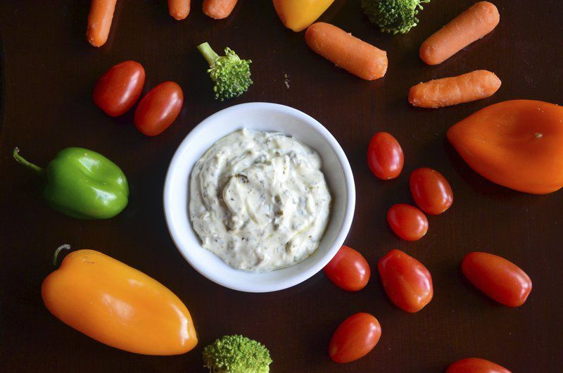 This Simple Pesto Dip serves as a great vegetable dip, but leftovers are also good drizzled on grilled bell peppers or zucchini. The dip is wonderful on turkey sandwiches or BLTs.