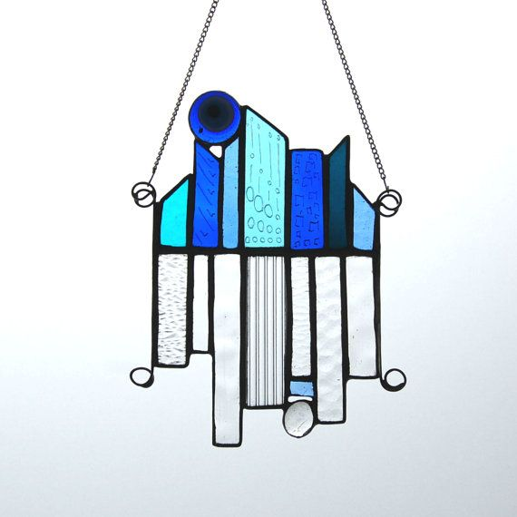 Blue&Clear Scape This quirky stained glass sun catcher in deep blues ...