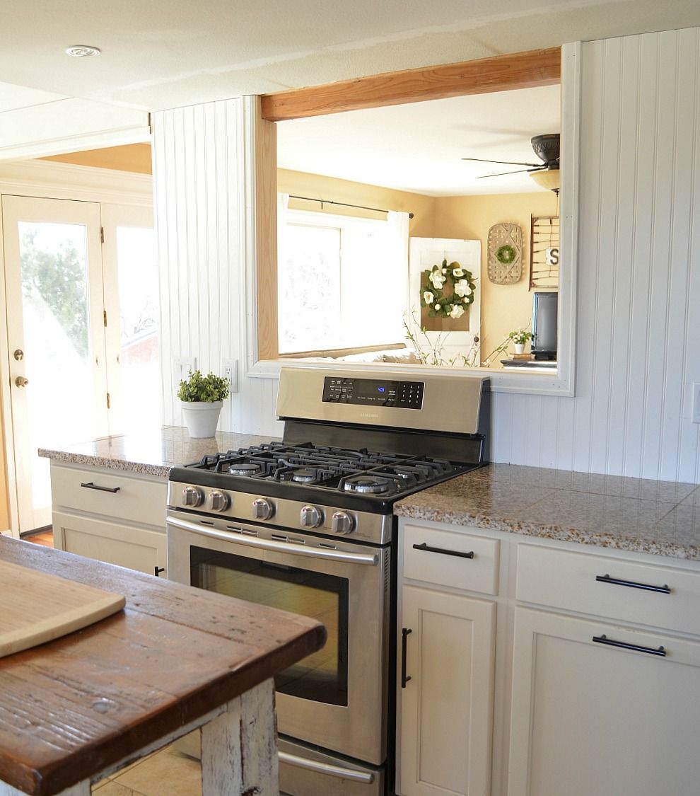 Come see how this farmhouse style kitchen was transformed when a passthrough was built in a load bearing wall between the kitchen and living room