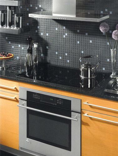 Charcoal grey mosaic backsplash with just a touch of color ...