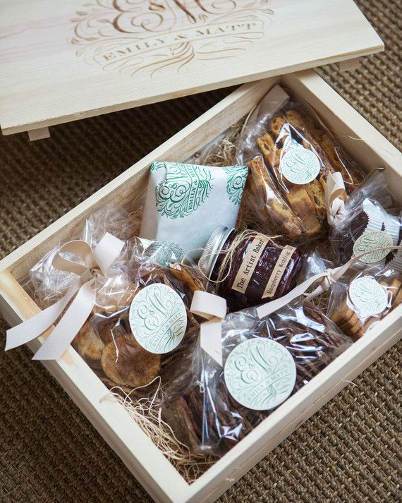 A wooden box filled with treats: heart-shaped shortbread cookies and raspberry Champagne preserves...