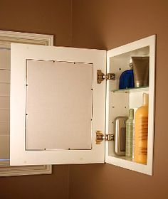 Use A Framed Picture And Hidden Hinges To Hide A Storage Cubby Small Bathroom Makeover Recessed Medicine Cabinet Small Bathroom Storage