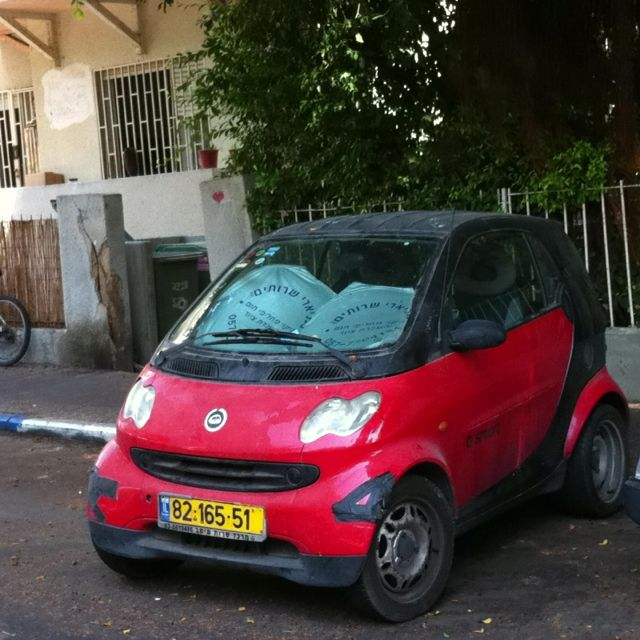 The best way to Park. Sideways. Smart car it is indeed.