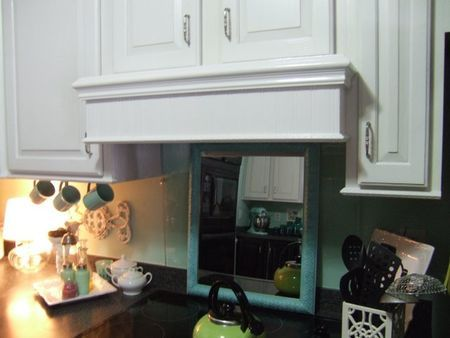 range hood website shows how they did it over an existing small range hood - Stove Hoods