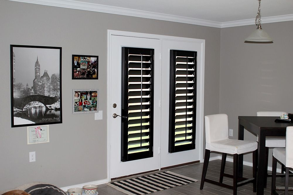 Black painted plantation shutters on the back doors AWF Black
