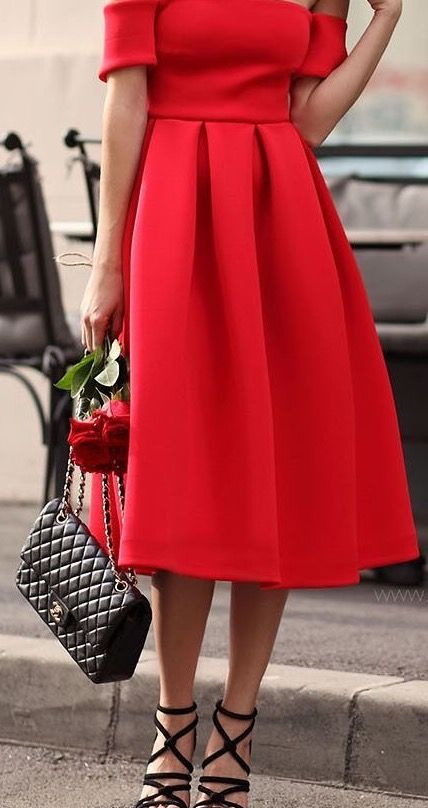 Lady in red. Love this midi length red dress