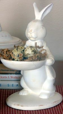 .Decorative rabbit holding a bird's nest