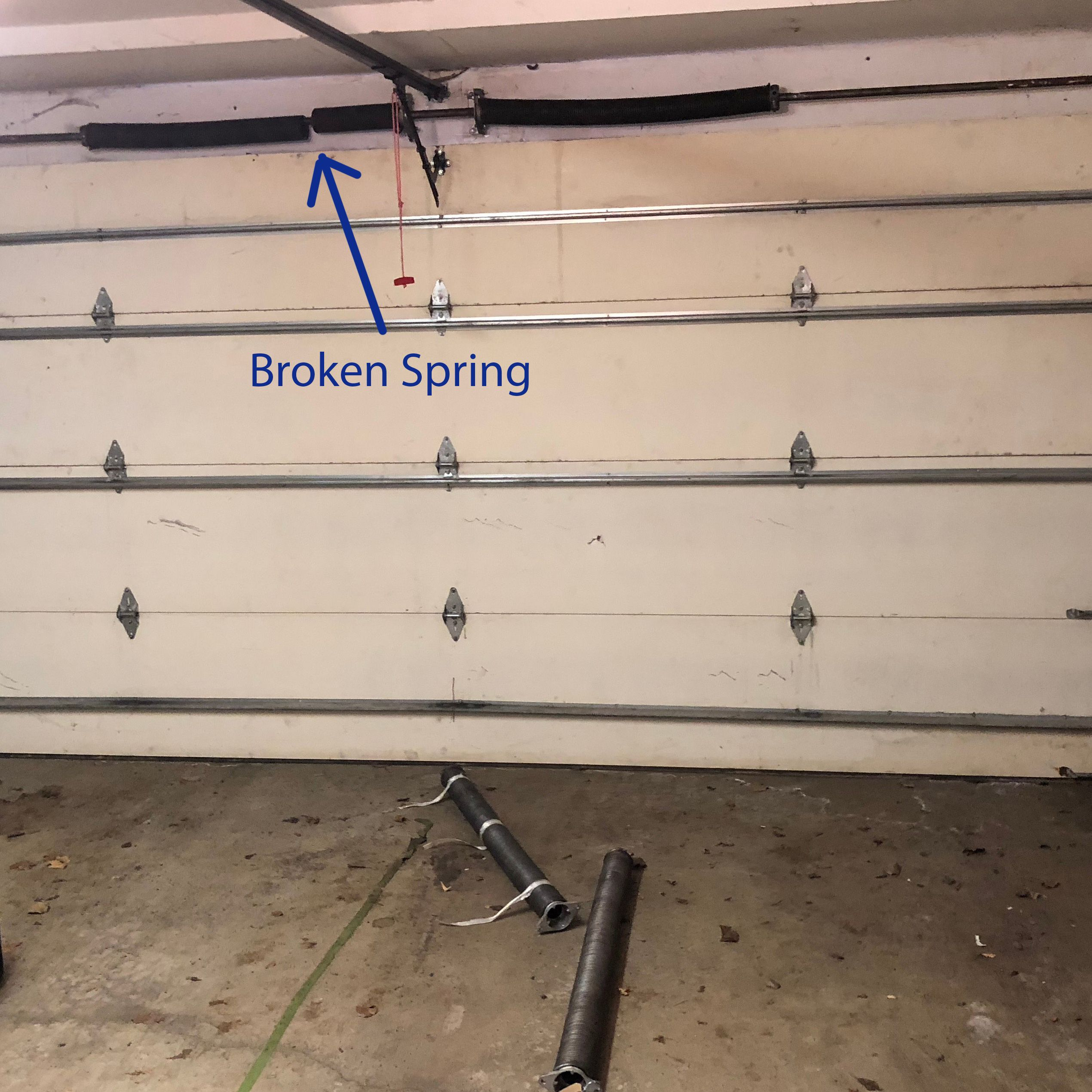 What Does A Broken Garage Door Spring Look Like Garage Door Spring Replacement Garage Door Springs Garage Door Spring Repair