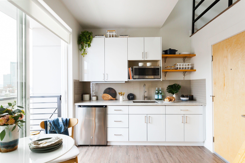 stunning white seattle apartment studio kitchen with