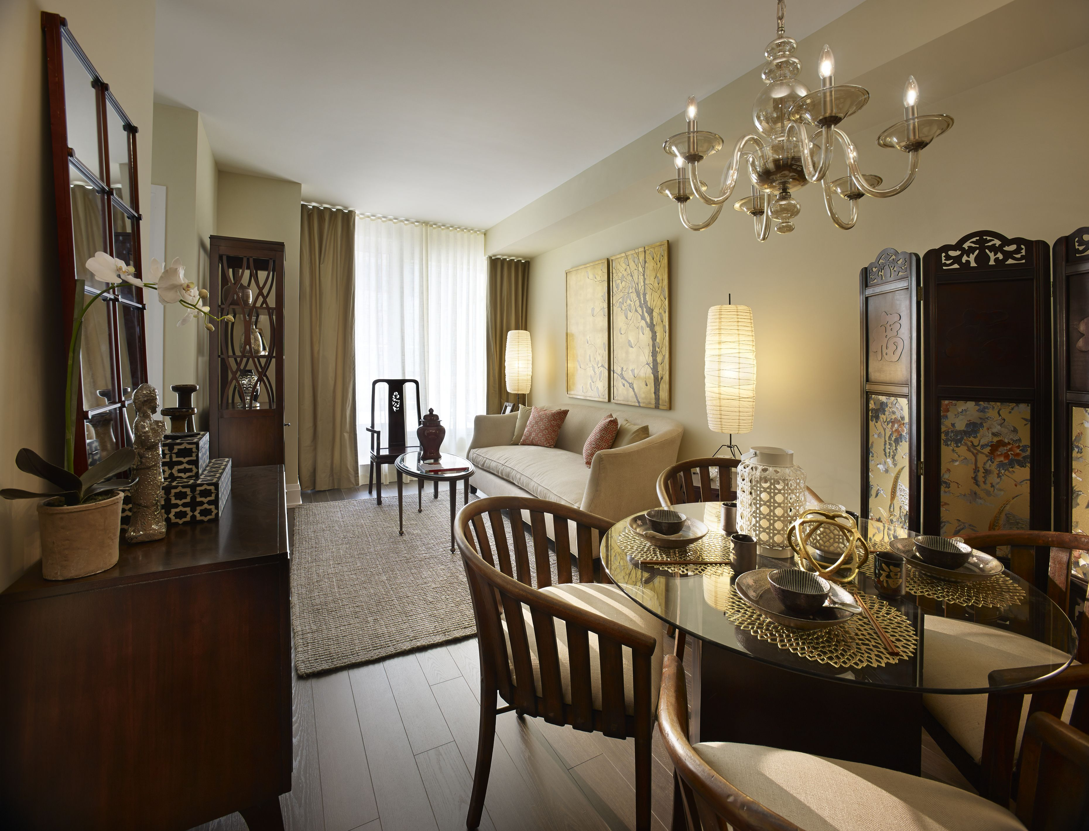 The Living And Dining Room Of AsianSilk Designer Model Suite At Aristo Avonshire Traditional Glass Asian Inspired Chandelier Calming Neutral