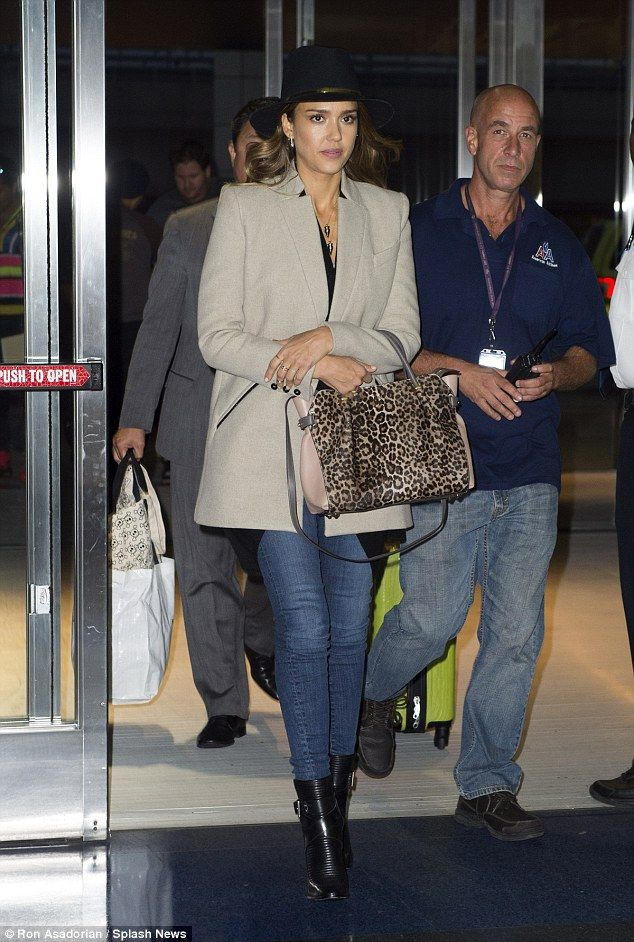 Jessica Alba rocks chic airport outfit before slip