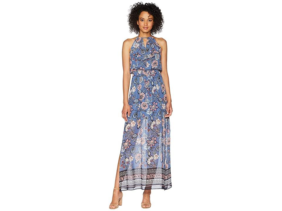 Vince Camuto Printed Chiffon Maxi with Ruffle Bodice (Blue Multi) Women's Dress. Brighten up the room in this Vince Camuto Printed Chiffon Maxi with Ruffle Bodice. Sleeveless maxi dress in a blouson silhouette. Bold print on a chiffon fabrication. Keyhole cutout at front of halter neckline. Ruffled overlay at front of bodice. Self-ties at elastic waist. Concealed hook and zipper closure at back. Flirty side slits. Dress is par #VinceCamuto #Apparel #Top #Dress #Blue
