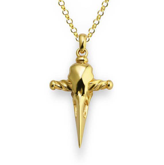 Etsy listing at https://www.etsy.com/uk/listing/527073287/raven-skull-dagger-pendant