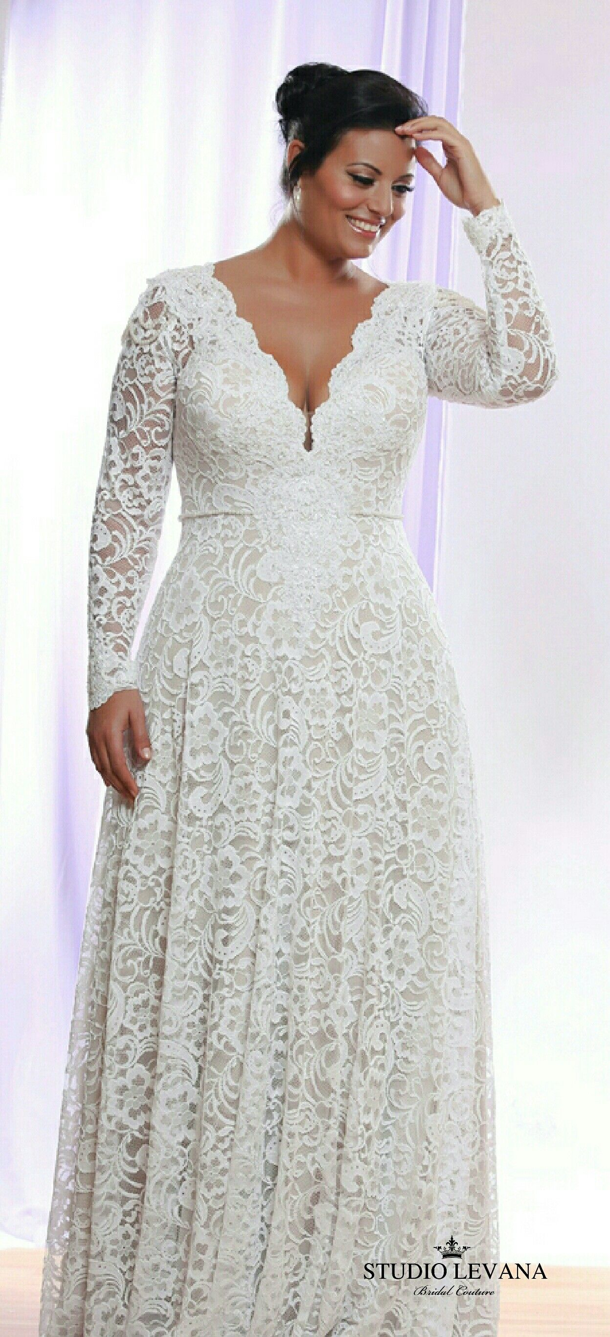 Plus size lace corset wedding gown with long sleeves and