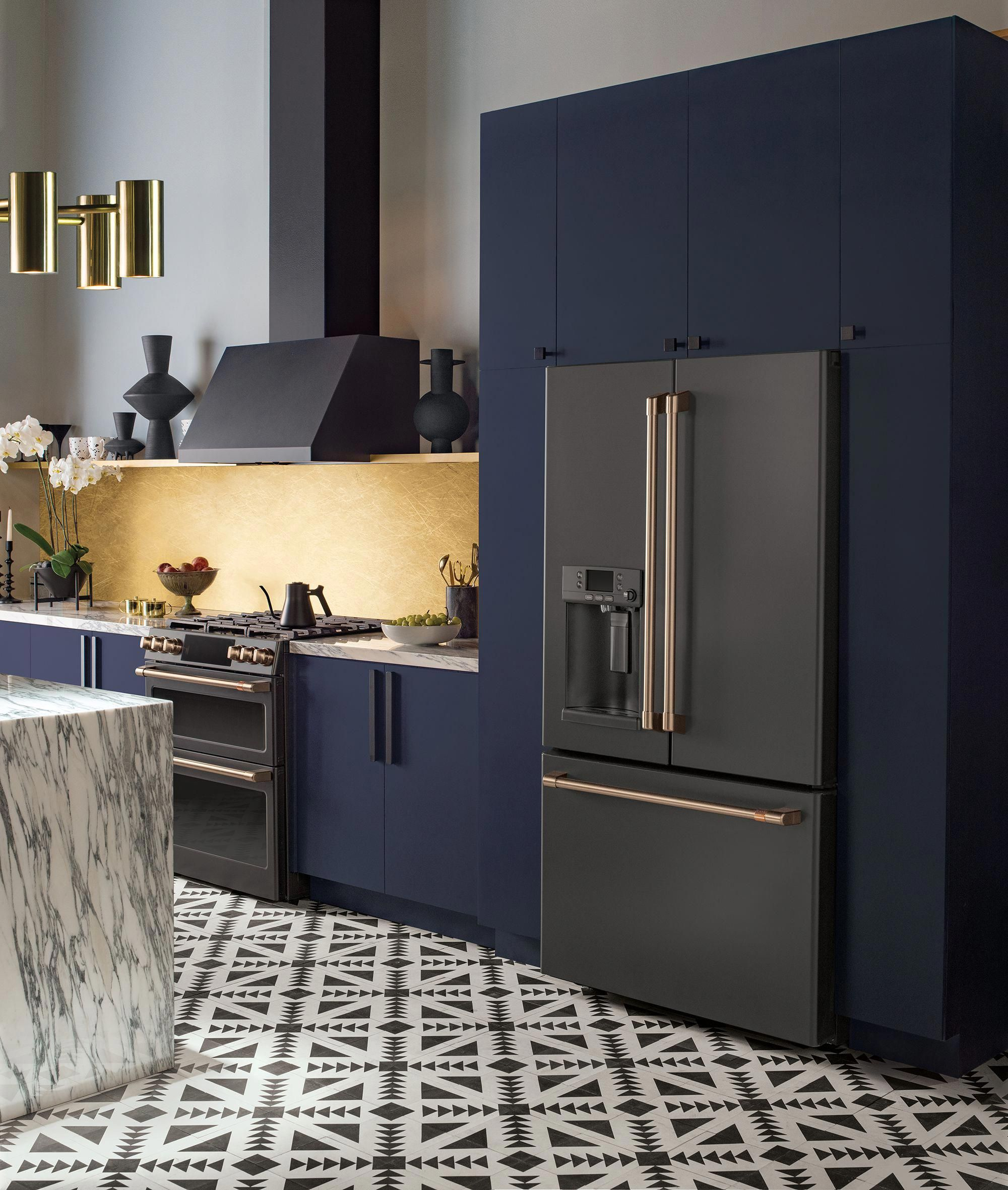 Luxury modern kitchen with midnight blue cabinets and beautiful @cafeappliances Matte Collection black appliances with Brushed Bronze finishes. #kitchen #modern #blue #black #appliances #luxury #kitchendesign