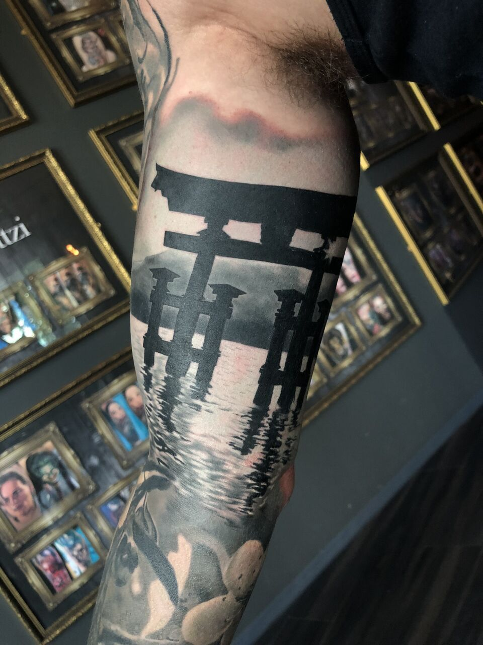 Photo of Japanese Shinto Gate tattoo by Laci.  Limited availability at Redemption Tattoo …