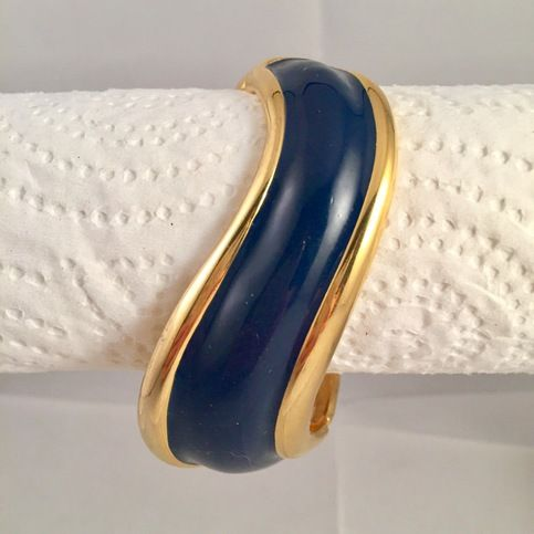 Napier+goldtone+metal+hinged+bracelet+with+navy+blue+enamel.+ Organic+wave+form.+ Tongue+and+groove+clasp. Pre-owned+costume+jewelry.+ Some+signs+of+aging.
