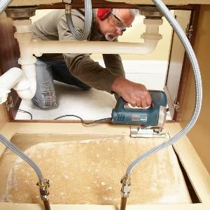 How to Replace a Sink Base Cabinet Floor: The flimsy particleboard bottoms in most kitchen and bathroom sink bases are often swollen and moldy from leaks. The best fix is to cut them out and replace them.