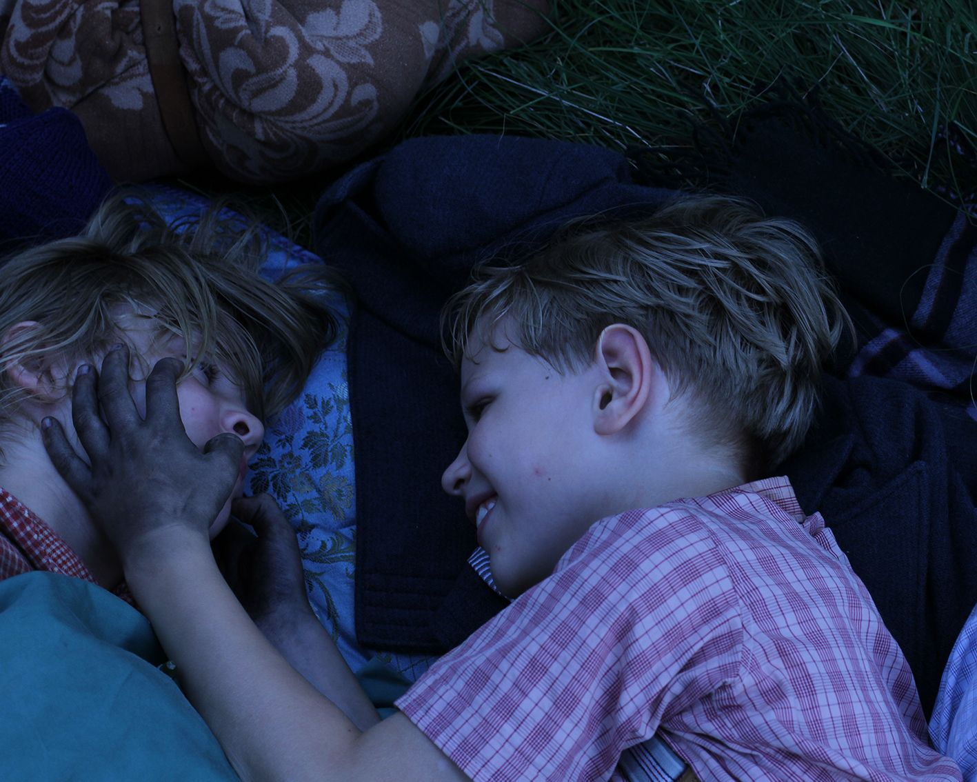 A moment of lightness between Lore and her little brother in the otherwise threatening atmosphere after the downfall of Nazi Germany. Lore is in cinemas and Curzon Home Cinema now!