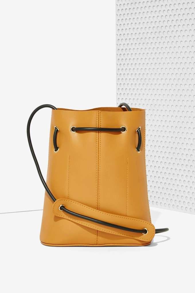 8b0ed26c1c43 Paradigm Vegan Leather Bucket Bag - Brown - Bags + Backpacks