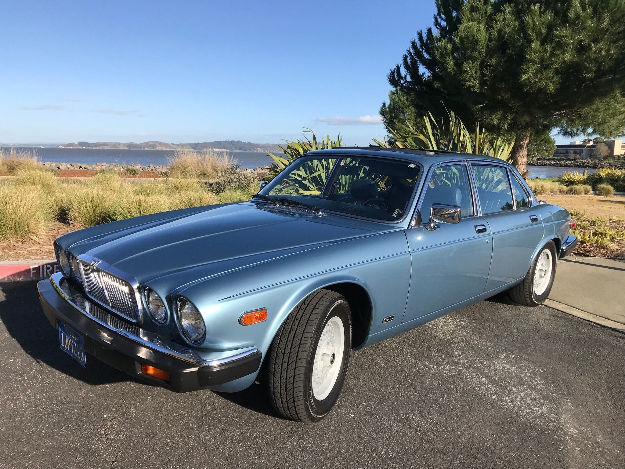 Bid for the chance to own a Jaguar XJ at auction with Bring a